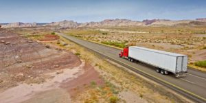 truck on open highway in desert